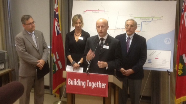 TTC CEO Andy Byford, second from right, speaks alongside Metrolinx president Bruce McCuaig, left, TTC chair Karen Stintz and Transportation Minister Bob Chiarelli, right, during a news conference Wednesday, Oct. 3, 2012. (CP24/Cam Woolley)