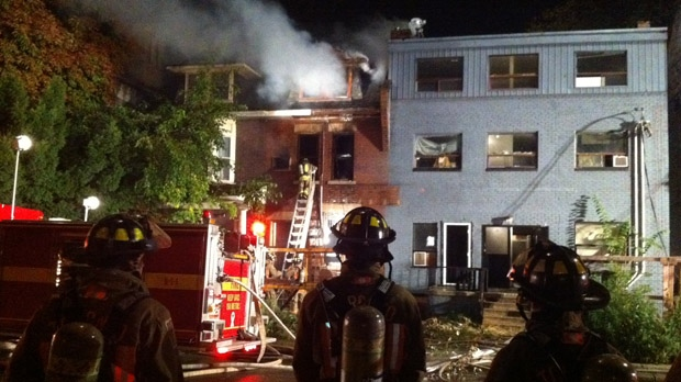 Firefighters battle a blaze on George Street in Toronto early Thursday, Oct. 4, 2012. (CP24/Tom Stefanac)