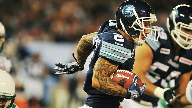 Toronto Argonauts Chad Owens runs the ball against the Saskatchewan Roughriders during first half CFL action in Toronto on Monday, Oct. 8, 2012. (CP Photo/Aaron Vincent Elkaim)