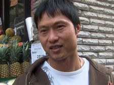 David Chen is seen outside the is shop on Spadina Avenue in Toronto, Sunday, Oct. 3, 2010.d