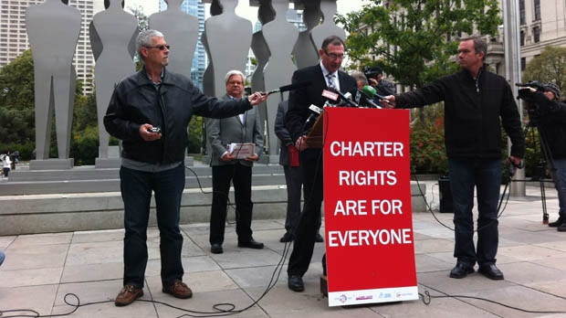 Union officials representing public school teachers and other employees speak outside the University Avenue courthouse in Toronto on Thursday, Oct. 11, 2012. (CP24/Mathew Reid)