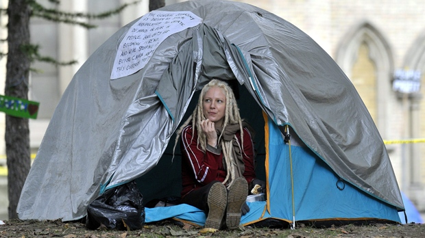 A protester sits in her tent at the Occupy Toronto encampment in St. James Park in Toronto on Sunday, Oct. 16, 2011. (The Canadian Press/J.P. Moczulski)