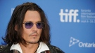 "In this Sept. 8, 2012 file photo, actor Johnny Depp participates in a photo call and press conference for the film ""West of Memphis"" at TIFF Bell Lightbox during the Toronto International Film Festival, in Toronto. (Photo by Evan Agostini/Invision/AP)"