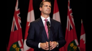 Ontario Premier Dalton McGuinty listens to a question as he speaks to the media at Queen's Park after announcing his resignation in Toronto on Monday, October 15, 2012.  He has led the party since 1996, becoming premier in 2003. (The Canadian Press/Michelle Siu)