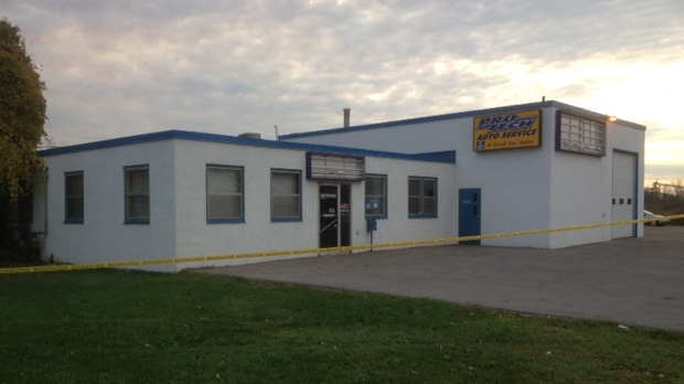 Police tape surrounds a Whitby auto repair shop after a lengthy standoff ended Wednesday, Oct. 17, 2012. (CP24/Cam Woolley)